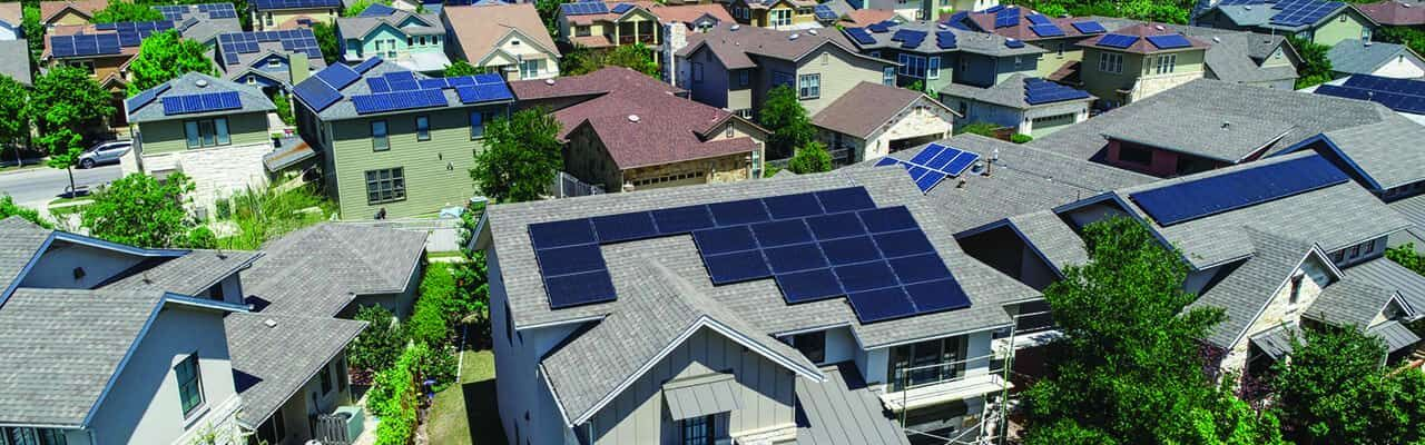 Aerial drone view of suburb neighborhood in East Austin community houses and homes - Mueller Suburb Solar Panel Rooftops and Modern Austin Living